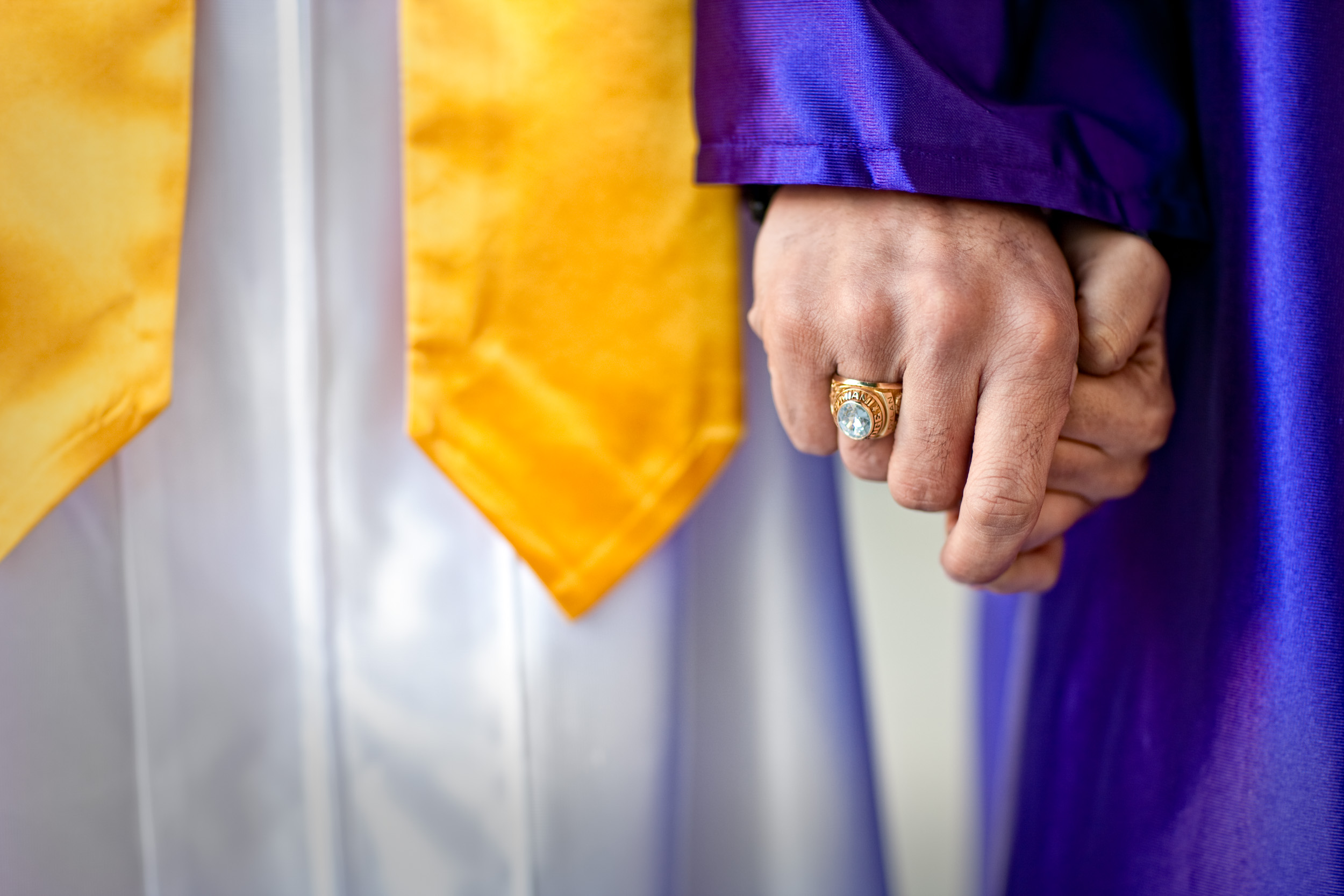 Graduates holding hands, shot by Steven P. Widoff,  editorial, lifestyle and advertising commercial photographer in Tampa, Florida.