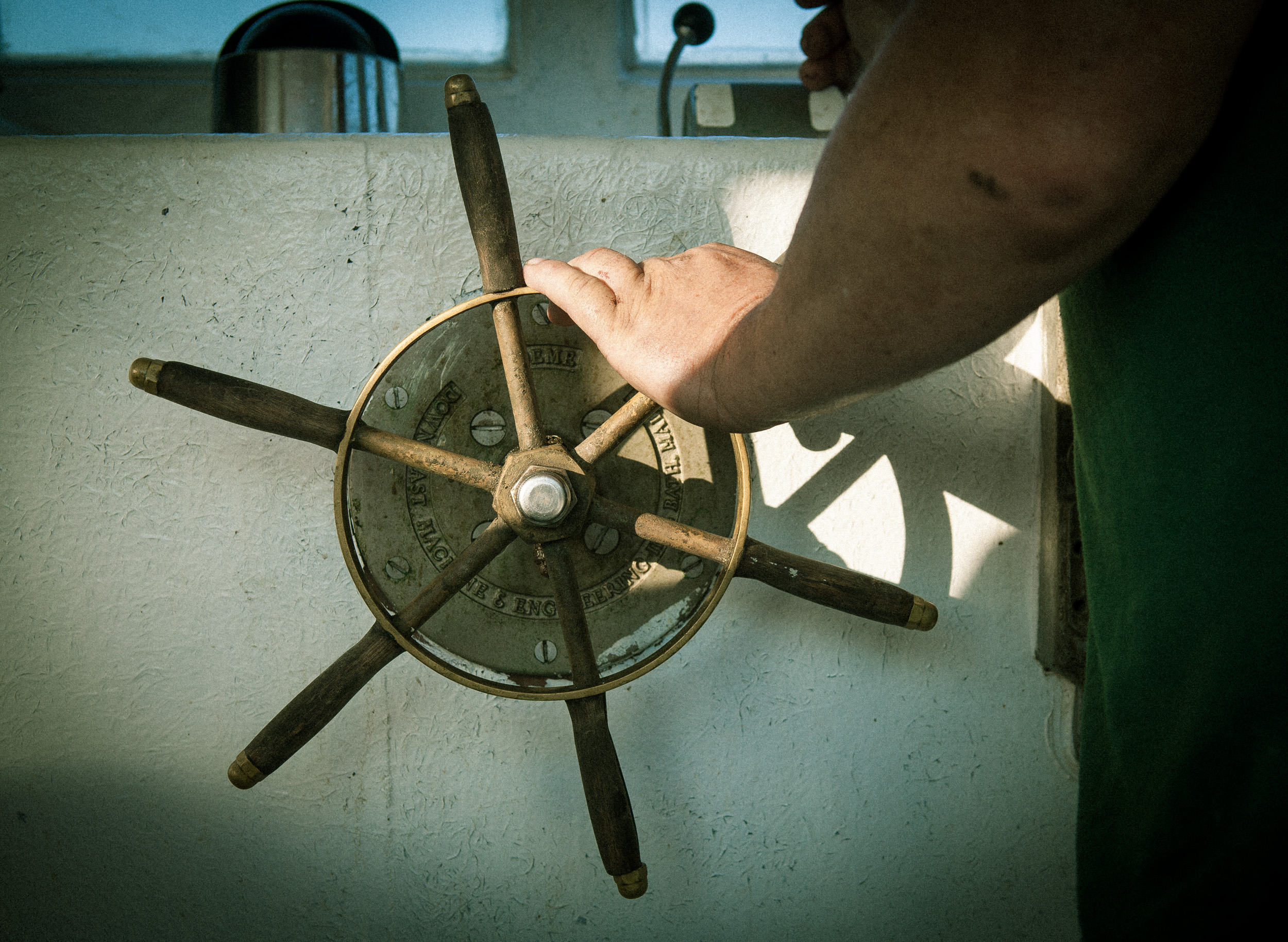 Boat steering wheel, shot by Steven P. Widoff