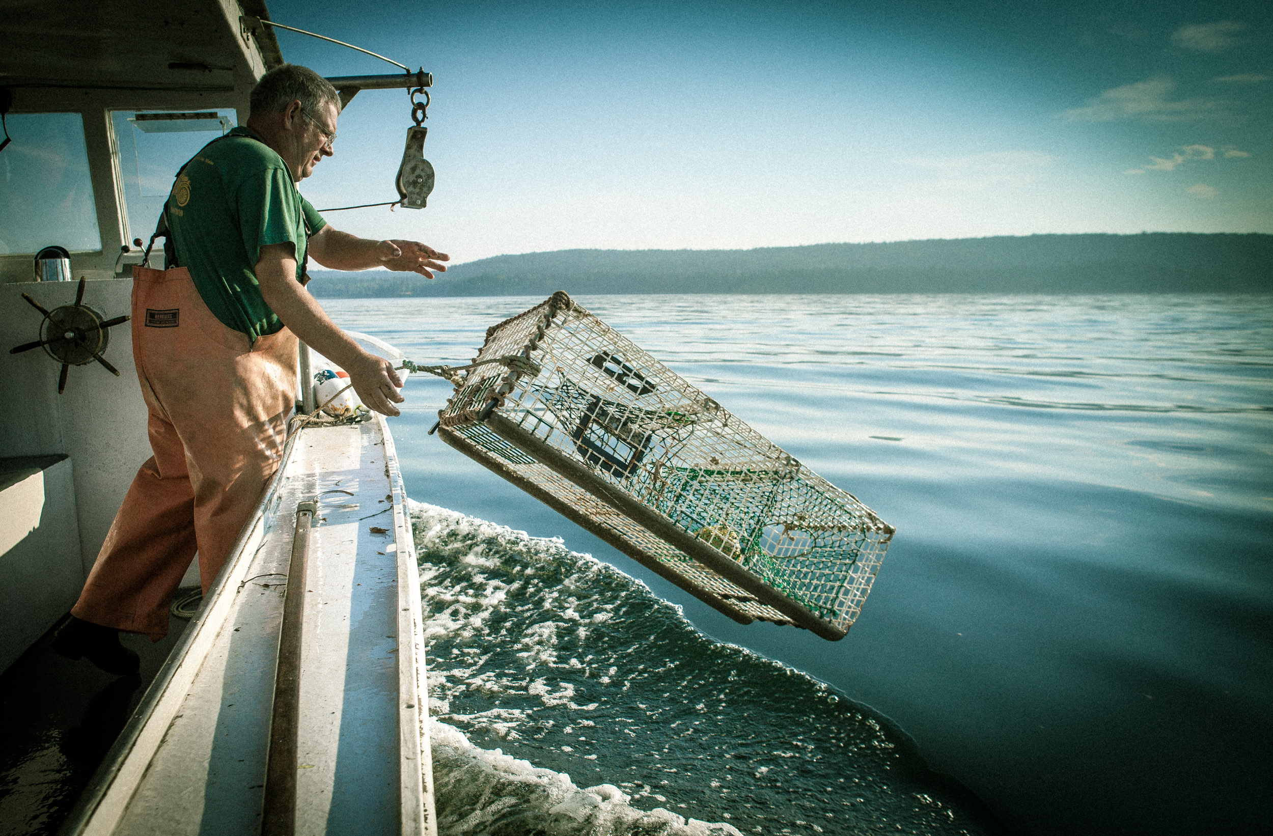 Man and lobster trap, Maine,  shot by Steven P. Widoff