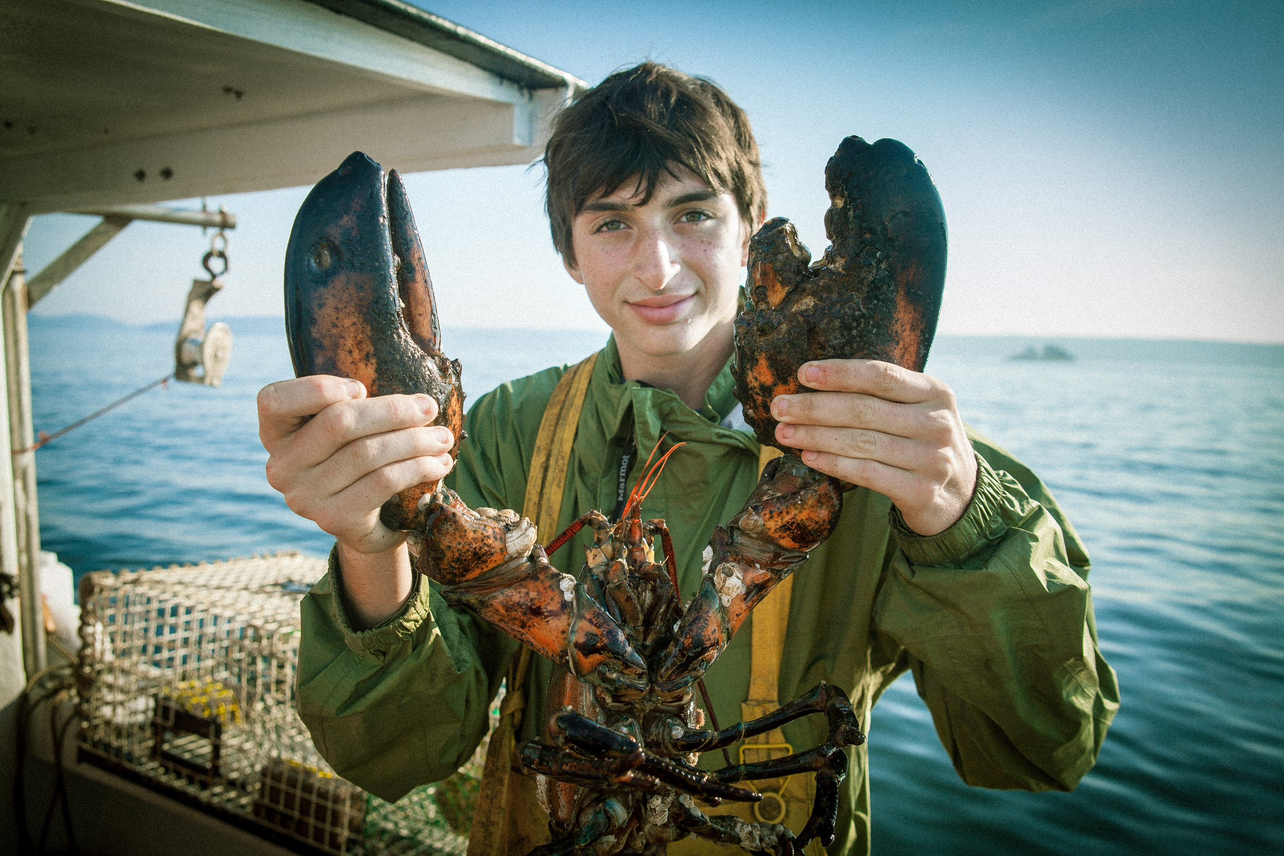 Boy holding lobster, shot by Steven P. Widoff