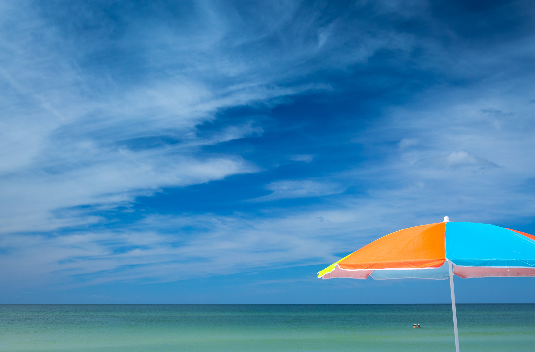 Vibrant umbrella on Florida beach, shot by Steven P. Widoff, editorial, lifestyle and advertising commercial photographer in Tampa, Florida.
