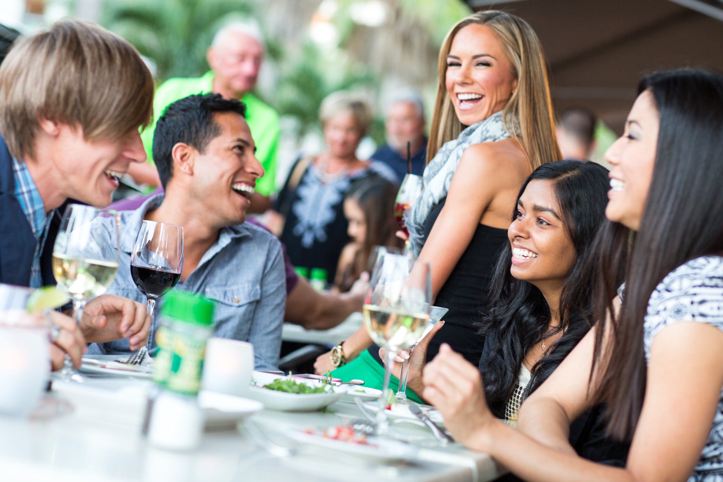 Young Adults laughing at outdoor restaurant