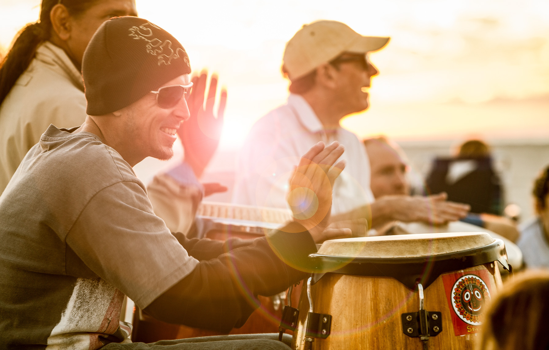 Drum Circle on beach, shot by Steven P. Widoff, editorial, lifestyle and advertising commercial photographer in Tampa, Florida.