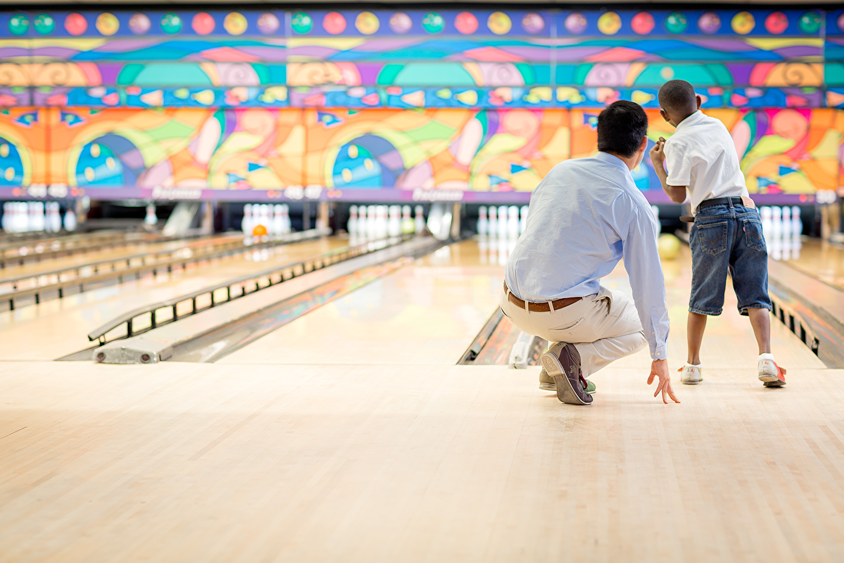 Adult and boy bowling, shot by Steven P. Widoff