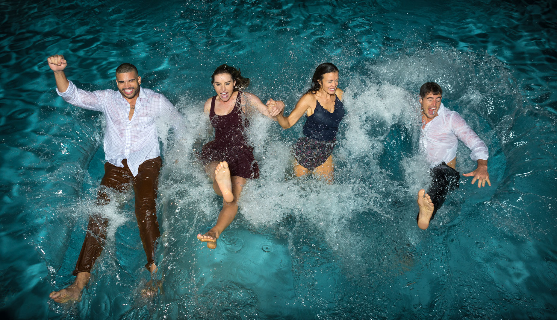 Four friends falling into pool, fully dressed, shot by Steven P. Widoff