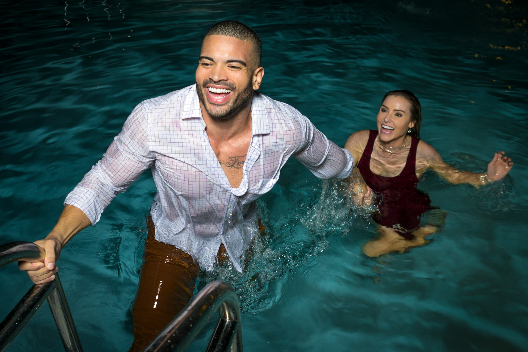 couple getting out of pool, fully dressed, shot by Steven P. Widoff