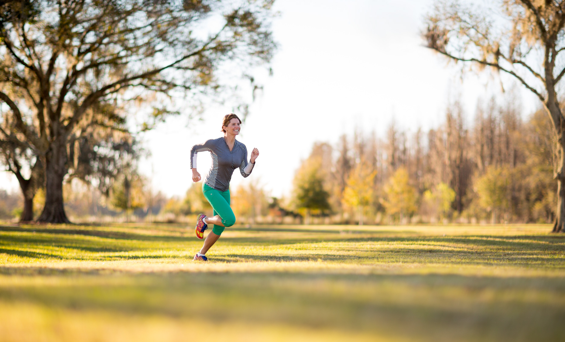 woman running outside in a park, shot by Steven P. Widoff
